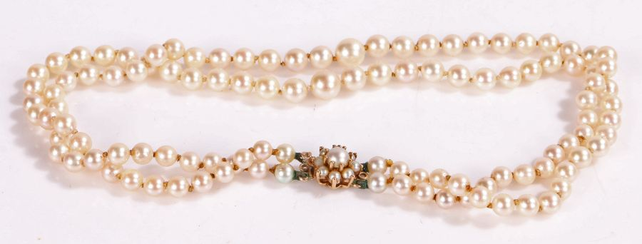 Simulated pearl necklace with a 9 carat gold clasp and two rows of pearls