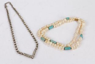 Paste necklace housed in a case together with pearl necklace