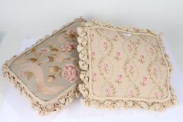 Two Chelsea textile embroidered cushions both depicting floral scenes, both have tassels surrounding