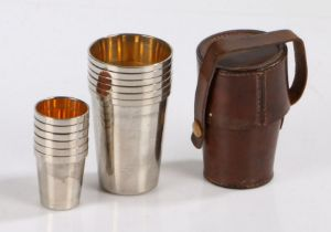 Set of six silver plated hunting tot cups and wine cups, of tapering form with gilt interiors,