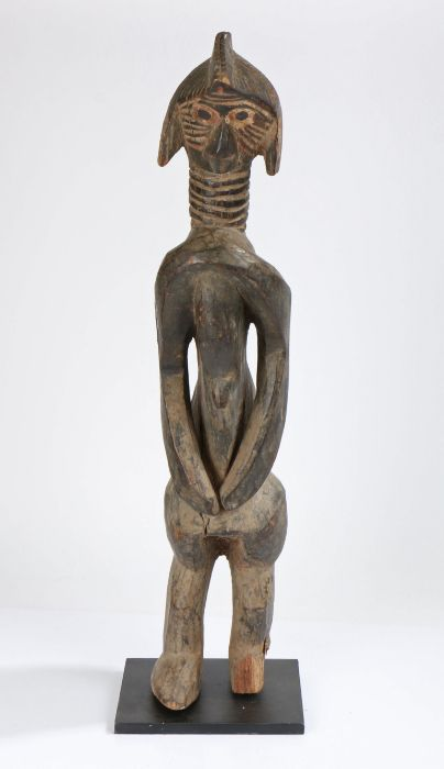 Sierra Leone Mende standing figure, the head with carved linear decorations, above a ringed neck,