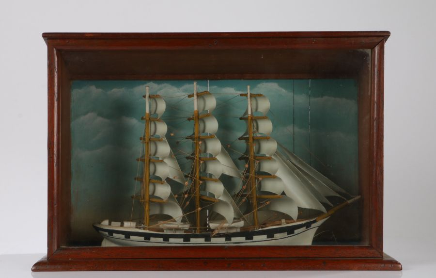 Model of a three masted ship in full sail, housed in a glazed mahogany case, 56.5cm wide, 37cm high,