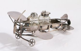 Silver plated novelty condiment set, maker MW & S, modelled as an early aeroplane, with central