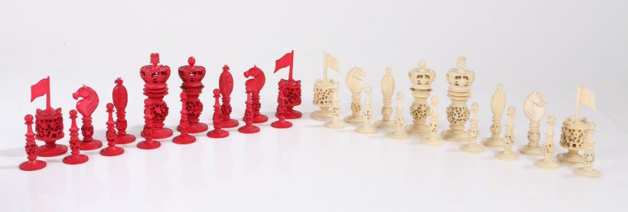 19th Century carved and stained chess set, with foliate pierced decoration, the king 9.5cm high