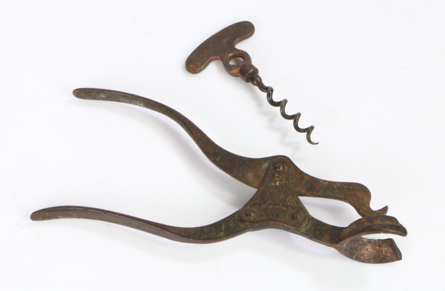 Mid 19th Century steel lever corkscrew, the handle with central cast section bearing a crest above