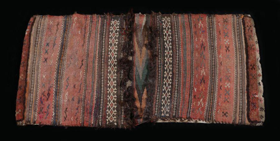 Turkoman saddle bag, with linear multicoloured patterns, 116cm x 55cm