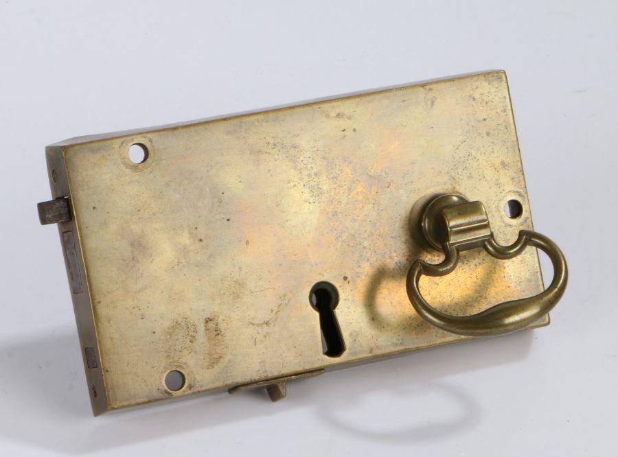 Georgian brass door lock, with pierced swing handle, 17cm wide, 9.5cm high