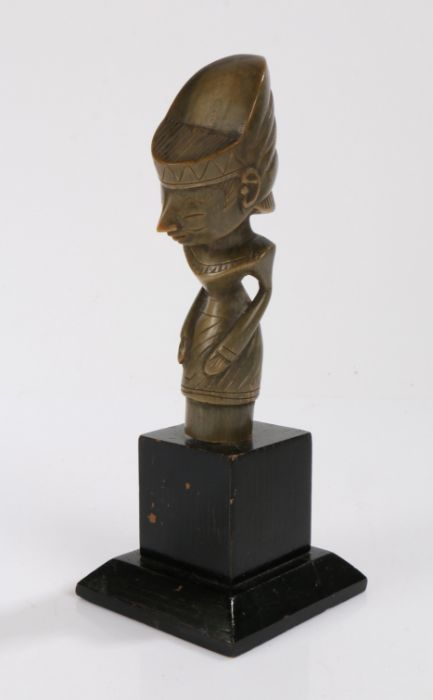 Tribal horn dagger handle, Possibly Malayan, the handle carved as a stylised figure, mounted on an