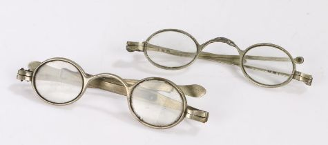 Two 19th Century silver spectacles with extending arms, mounted with lenses (2)