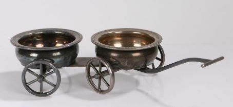 Silver plated novelty wine coaster trolley, the two coasters mounted to a four wheeled trolley