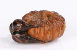 Japanese wood netsuke, Meiji period, carved as a pumpkin and three aubergines in a deep brown, 3.5cm