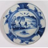 18th Century Delft plate, with a figure looking up at a tree and building, 23cm wide