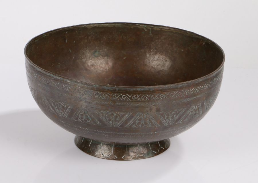 17th/18th Century Islamic copper bowl, the central field with foliate engraved decoration, the
