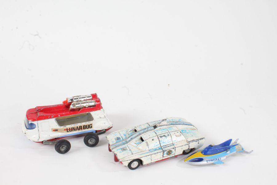 Corgi Comics Lunar Bug, Dinky Toys Maximum Security Vehicle, and a Matchbox Stingray (3)