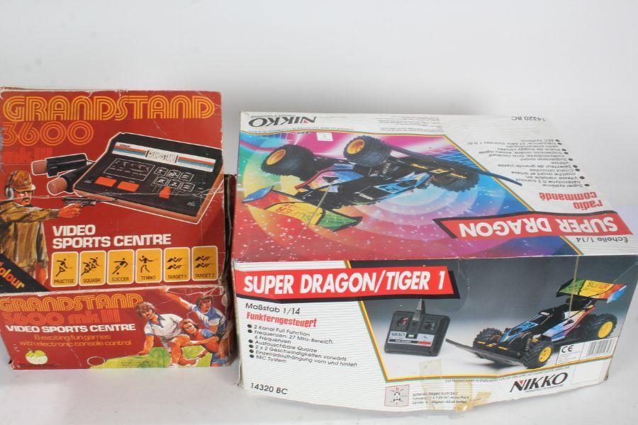 Nikko Super Dragon remote control car, XGO Offroad Tiger remote control truck, Grandstand 3600 MKIII