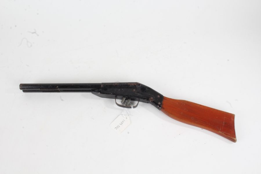 Tin plate sawn off shotgun, with wooden stock, 52cm long