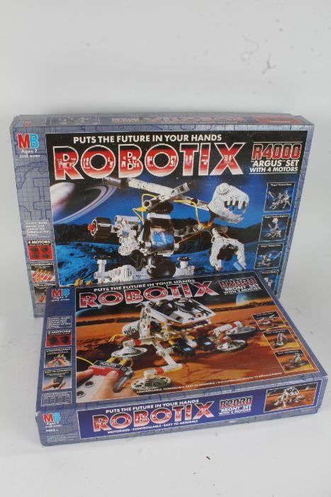 Four boxed sets of Robotix, R4000 Argus, R2030 Bront, R740 Lunax, R40 Motorpack (4)