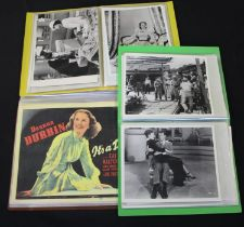 Extensive collection of Deanna Durbin interest photographs, including ten lobby cards, housed in
