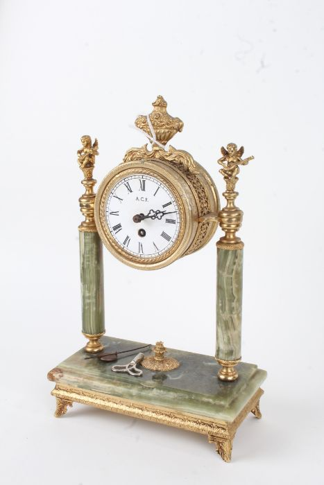 20th century onyx and brass portico clock, having white dial with black Roman numerals, mounted with