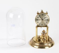 German anniversary clock, the silvered dial with Arabic numerals above four rotating orb weights,