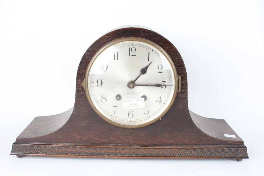 1920's/30's oak cased mantel clock, the dial with Arabic numerals, twin train movement, 43cm wide
