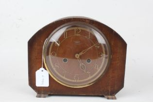 Smiths Enfield mantel clock, with arched case, the pierced brass effect dial with Arabic numerals,
