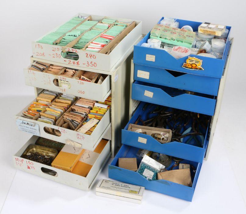 Plastic workshop bank of six drawers containing quartz watch movements, pliers etc. Similar ban k of