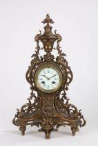19th Century French brass mantel clock, the foliate cast urn form pediment above a pierced scroll