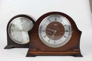 Two Smiths Enfield mantle clocks, the first having a bakelite arch shaped case with silvered dial,