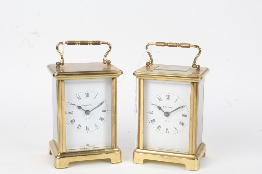Two Bayard brass cased carriage clocks, one with visible escapement, the white dials with Roman