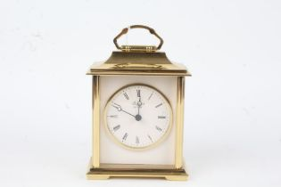 Brass carriage clock by Rapport, the white dial with Roman numerals, 14.5cm high