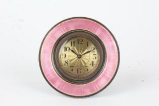 Puce enamel decorated boudoir clock, the circular case with puce enamel bezel, the engine turned