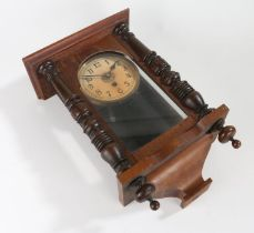 Edwardian mahogany wall clock, the cream dial with Arabic numerals, the glazed door flanked by