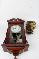Two brass clock movements, together with a modern 31 day wall clock AF (3)