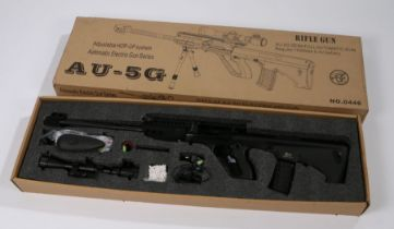 AU-5G Airsoft Electric Rifle in black, battery operated, vendor states in working condition,