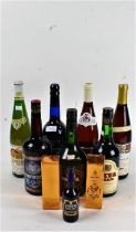 Collection of bottles of alcohol to include Harveys sherry, Cloberg white wine and various others (