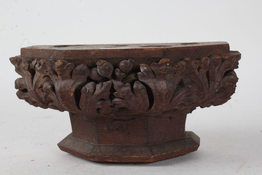 19th Century oak bracket, carved with foliage, 31.5cm wide