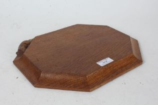 """Robert """"Mouseman"""" Thompson bread board, with carved mouse to the border, 30.5cm wide, 25cm deep"""