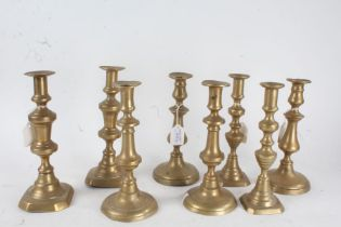 Four various pairs of 19th century brass candlesticks, the tallest 26cm (4)