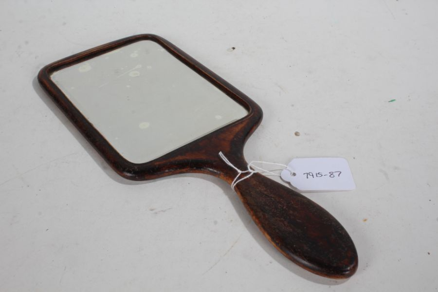 Late 19th/early 20th Century treen hand mirror, the back with a foliate design and monogram, 30.