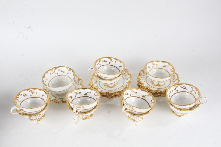 Crescent & Sons porcelain tea ware, including twelve cups and saucers and a bowl, decorated in
