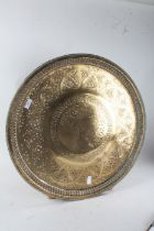 Indian Benares brass tray, with pierced foliate decoration and centred with a bird, 59cm diameter