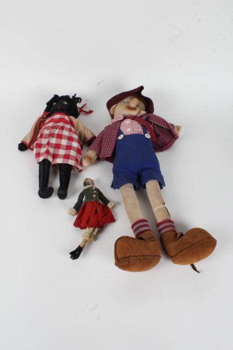 Three early 20th Century rag dolls, of varying sizes, the longest 58cm long (3)
