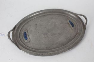 Arts and Crafts enamel mounted beaten pewter serving tray, of oval form with pierced carrying