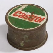 Castrol, a 1916 shell casing from a 4.5IN Howe I, with a Castrol design to the lid of the casing,