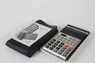 Casio fx-21 Scientific Calculator, housed in a leather case with instruction manual
