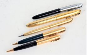 Waterman's propelling pencil, together with an Aurora fountain pen with yellow metal case, a