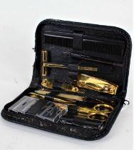 Pierre Cardin, leather cased travelling vanity set, comprising razor, comb, scissors, nail file
