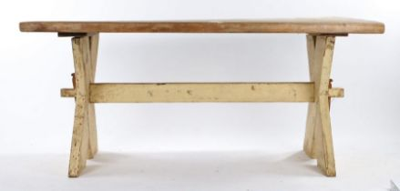 Early 20th Century pine and painted pine trestle end table, the rectangular top above X frame end