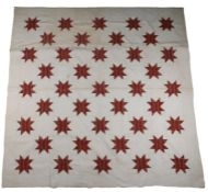 Early 20th Century patchwork quilt, with star design to the cream ground, 253cm x 245cm